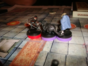 A Dragonborn Swordmage comes to the defense of a bloodied Rogue, and marks the Spectral Panther attacking.